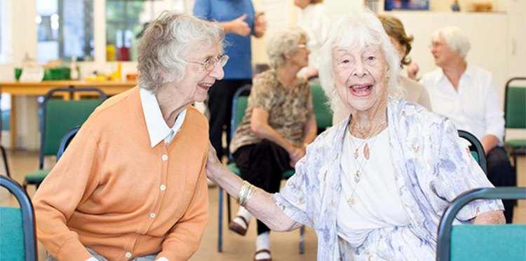 two_older_ladies_laughing_together